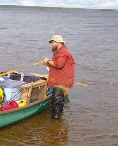 Dr. Neilsen loading a canoe at Ashuanipi Lake. (Todd Kristensen)
