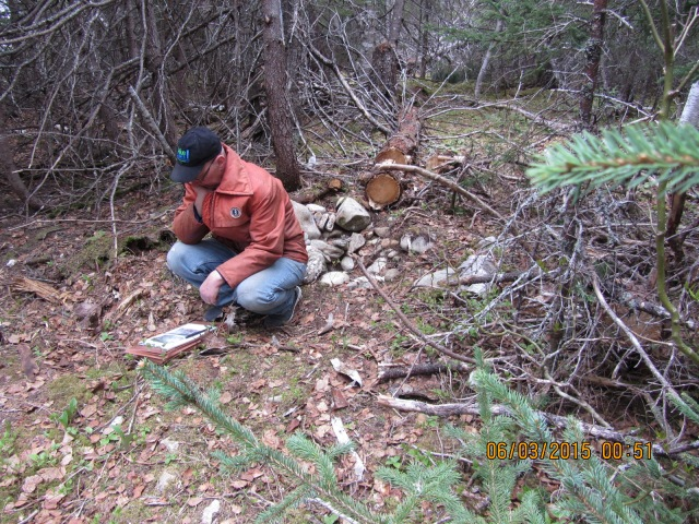 Ken on Two Mile Island, Exploit's River, pondering a Beothuk housepit 2015.